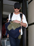 Ryan Gosling carried a green jacket along with his luggage.
