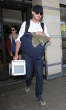 Ryan Gosling sported sneakers as he arrived at LAX.