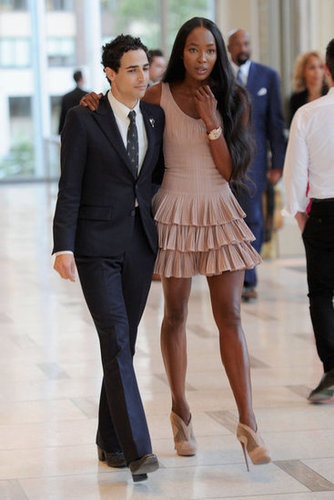 Naomi Campbell walked with Zac Posen before his show in a nude, frilly-hemmed minidress.