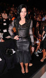 Leigh Lezark donned one of Hervé Léger by Max Azria's leather body-con dresses for the designer's Spring 2013 show.