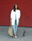 An architectural car coat in crisp, clean white gave a chic finish to boyfriend jeans.