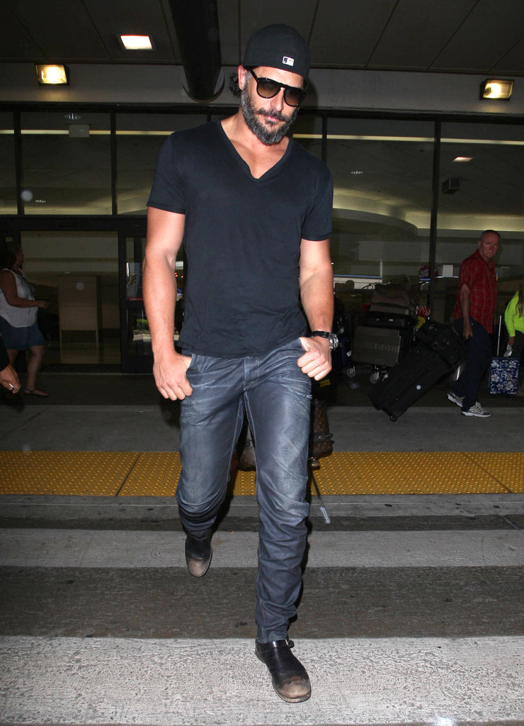 Joe Manganiello walked across the street at LAX Airport.