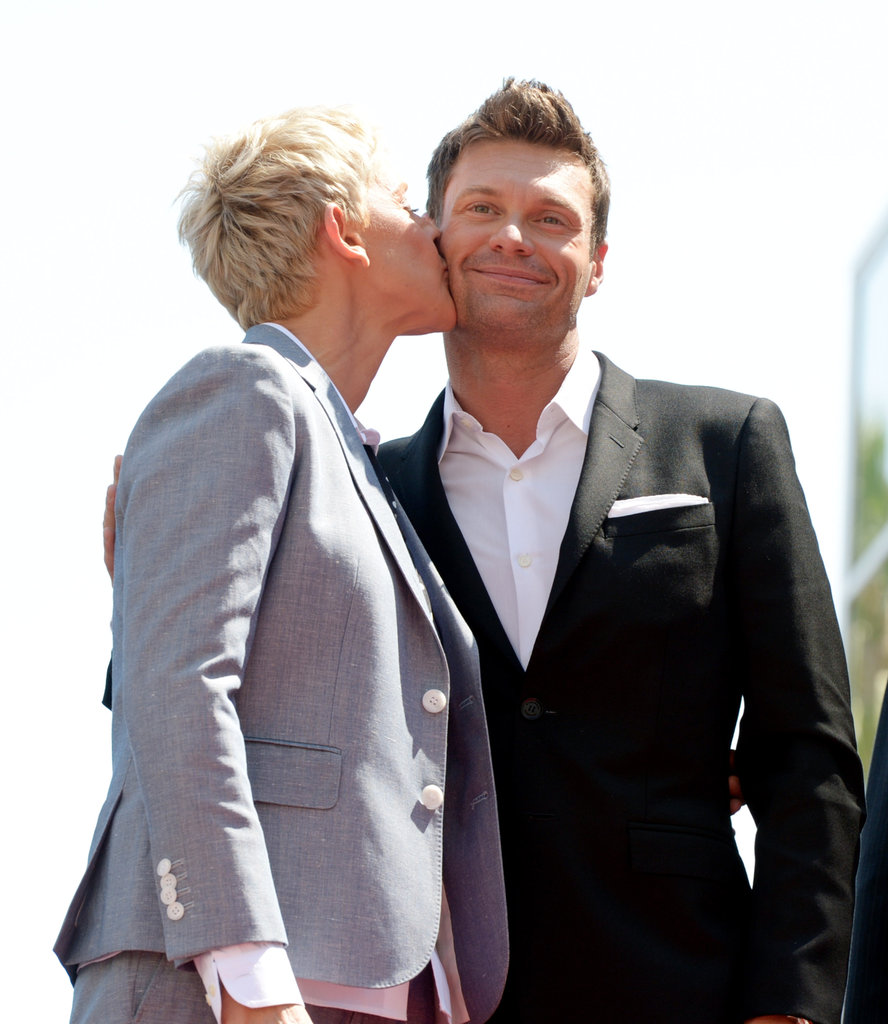 Ellen DeGeneres planted a kiss on Ryan Seacrest in Hollywood.