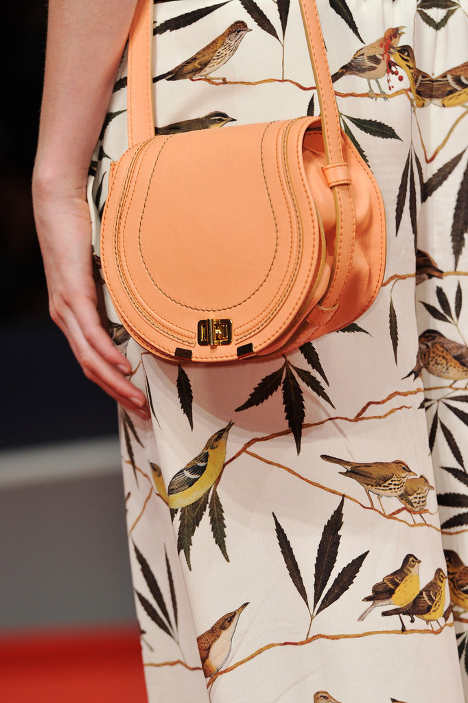 Her peachy Chloé satchel gave Lily Cole's printed look a solid pastel contrast.