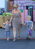 Amy Poehler bought sons Abel and Archie balloons while out in LA on Saturday.
