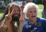 An elderly woman made a peace sign alongside a protestor during CarolinaFest that took place on the eve of the DNC.