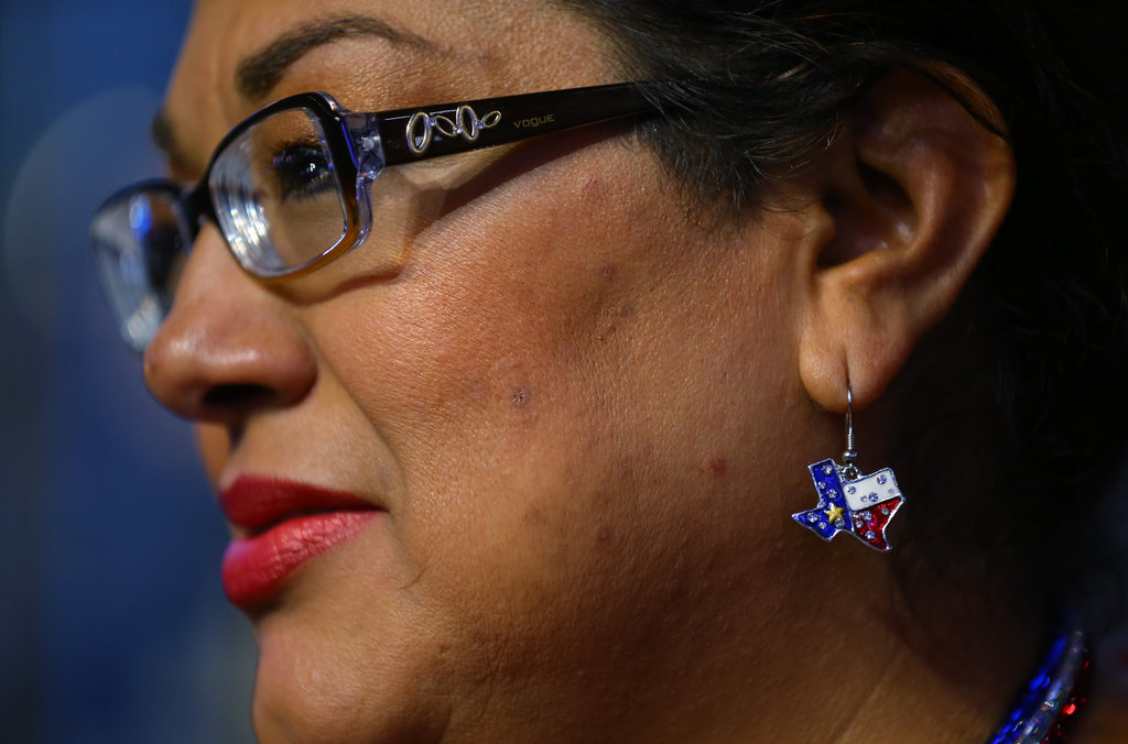 A woman wore patriotic earrings inside the convention.