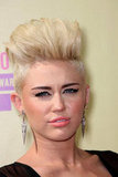 Miley Cyrus wore pink lips for the VMAs.
