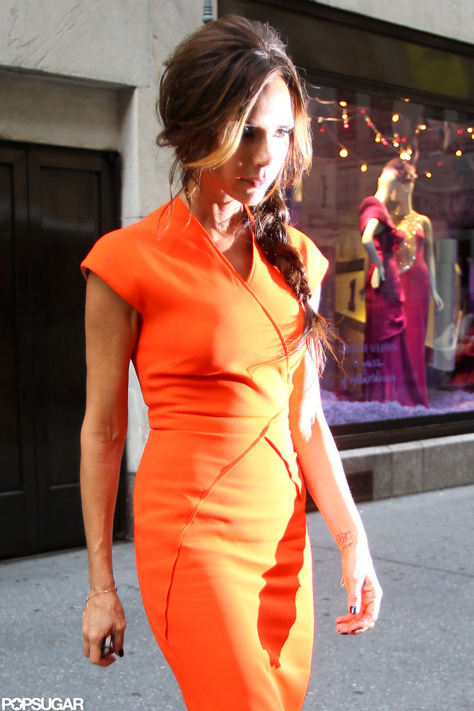 Victoria Beckham rocked bright orange.