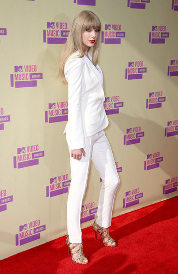 Taylor Swift Steps Out in a White Pantsuit For the VMAs