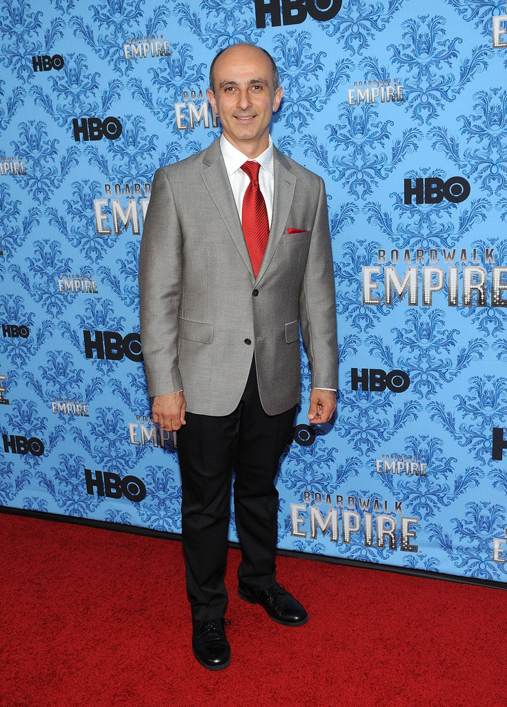 Stephen DeRosa stepped out in a gray suit and red tie.