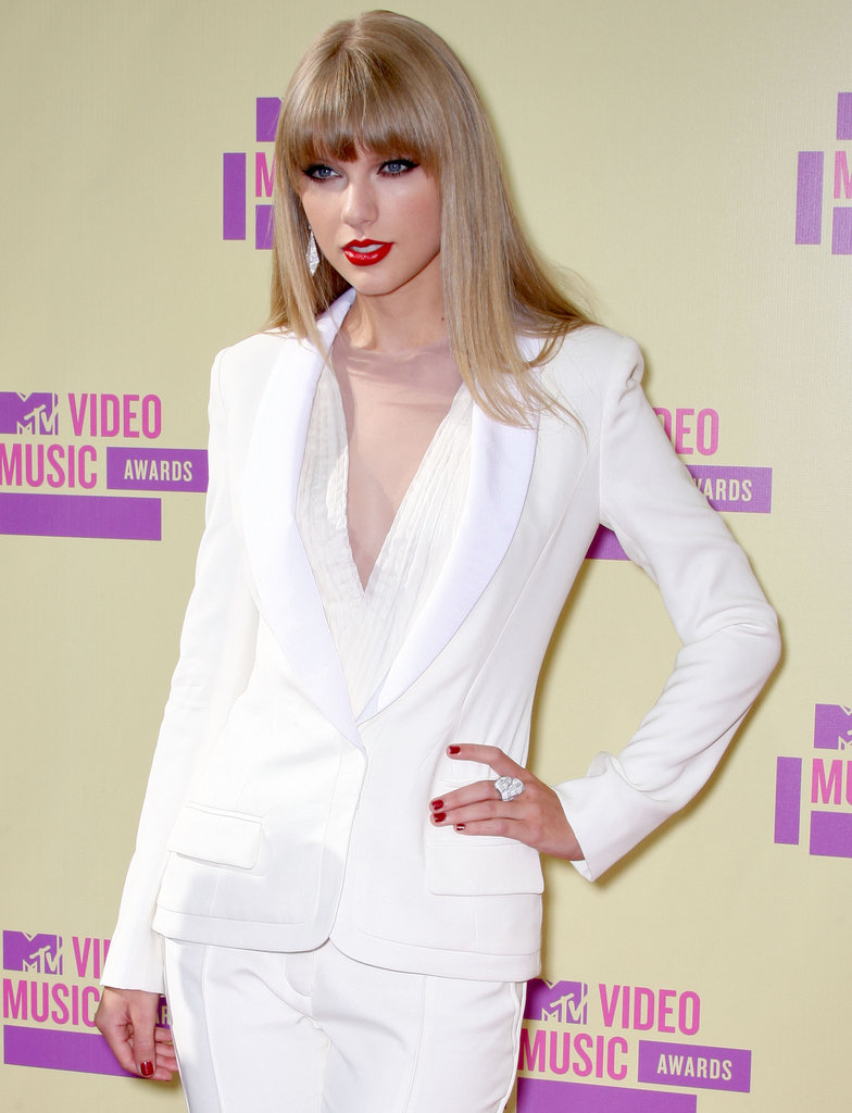 Taylor Swift posed in a white suit at the VMAs.