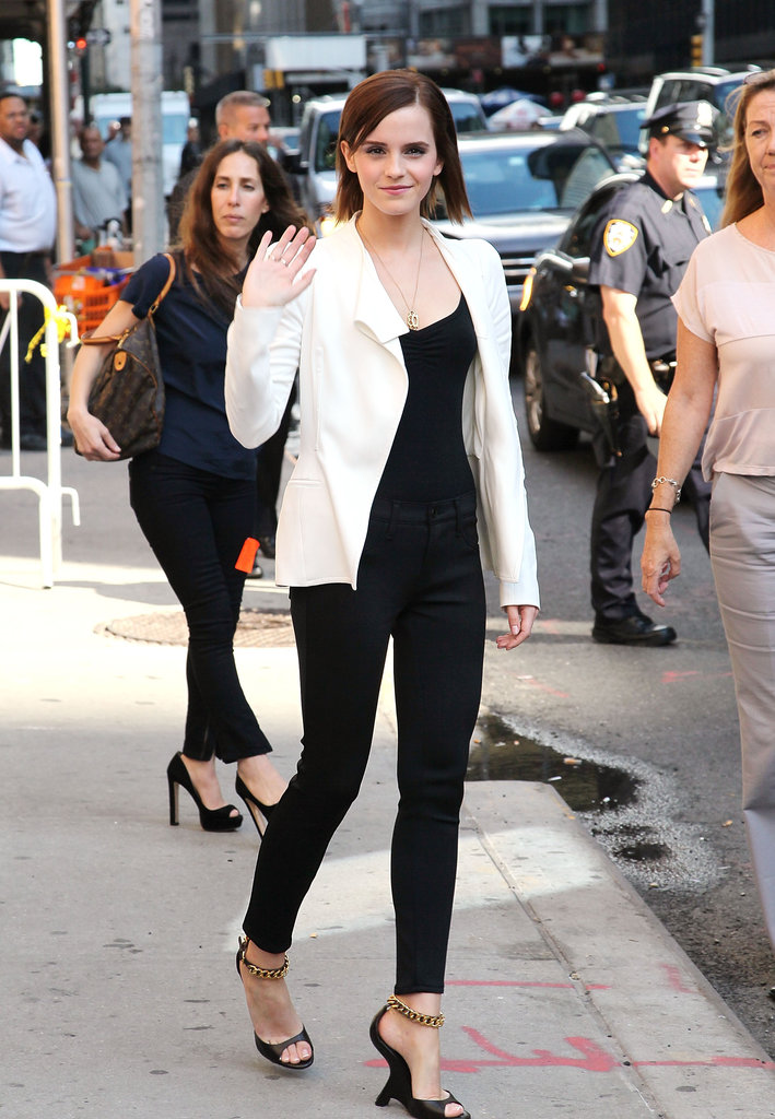 Emma Watson wore a white blazer over a black tank with black pants.