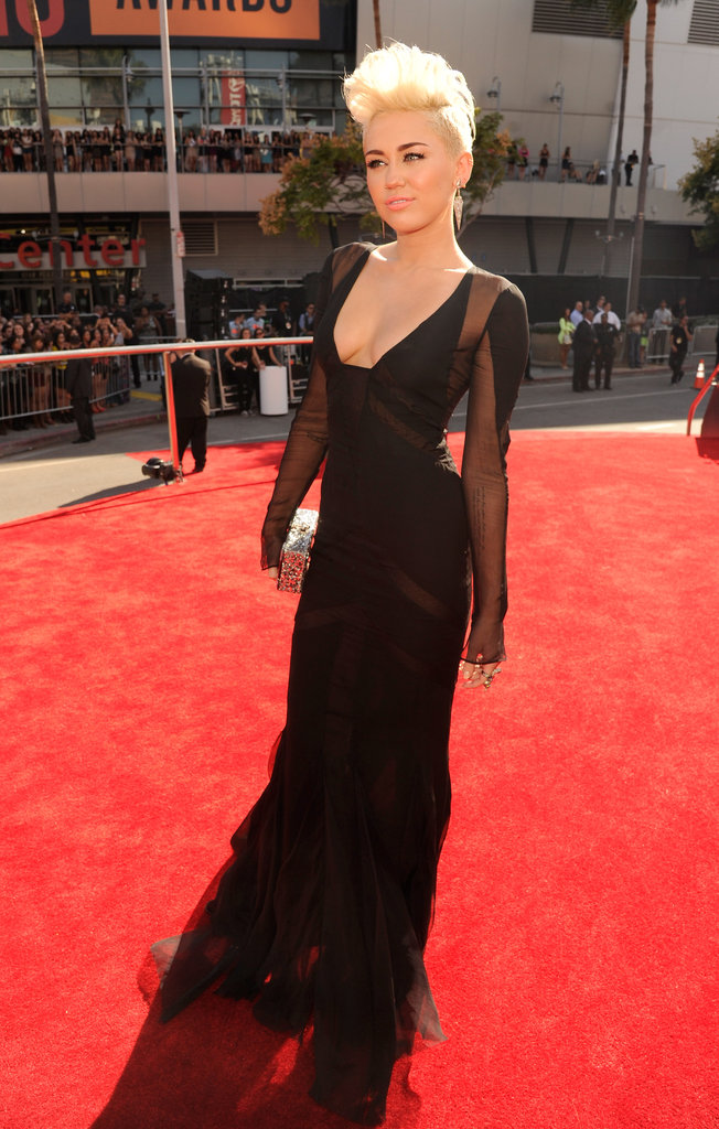 Miley Cyrus wore a black dress with plunging v-neck.