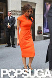 Victoria Beckham wore orange.