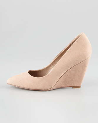 A leg-lengthening nude hue with a walkable wedge (win, win!).  Pour la Victoire Mai Nubuck Leather Wedge Pump ($220)