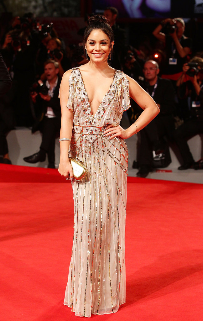 Vanessa Hudgens dared to bare just a little more via a plunging Temperley London neckline. In addition, the split sleeves and ultraembellished approach to this floor-length gown provided Vanessa with a serious glowing effect.