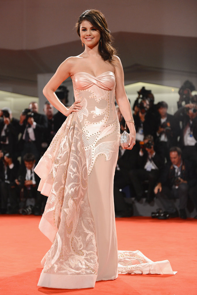 Selena Gomez wore a strapless nude gown by Atelier Versace for the Spring Breakers premiere. Her fierce ensemble caught our eye immediately with its embellished flamed embroidery and dramatic side ruffle train.