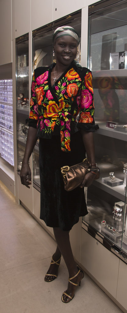 Alek Wek opted for a brilliantly printed blouse to offset her black skirt to ring in Fashion Week with Swarovski.