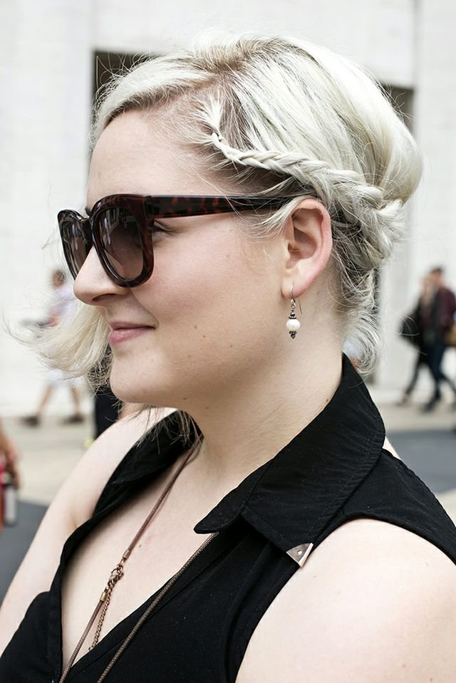 Platinum blond hair got amplified with an asymmetrical braided updo. Photo by Caroline Voagen Nelson