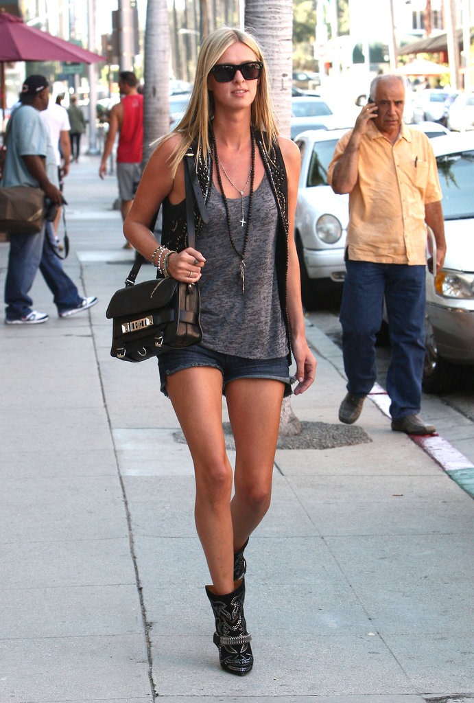 Nicky Hilton ran errands in LA in a rocker-cool gray tank and leather vest.