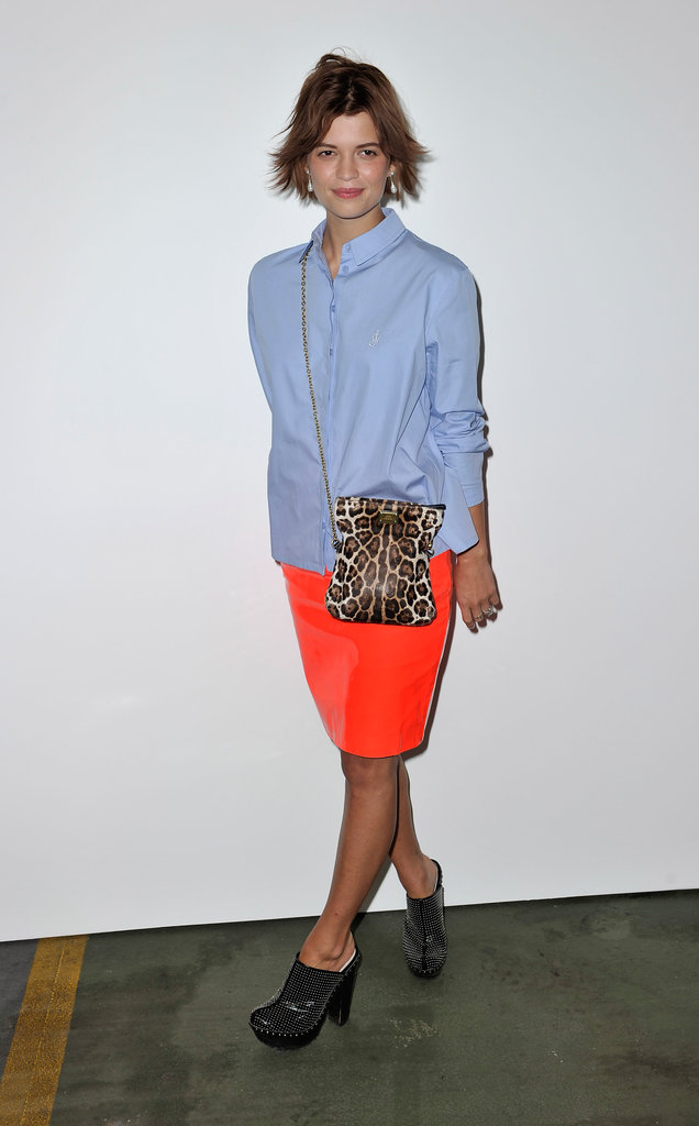 Pixie Geldof teamed a blue shirt with a neon skirt and leopard print bag at House of Holland.