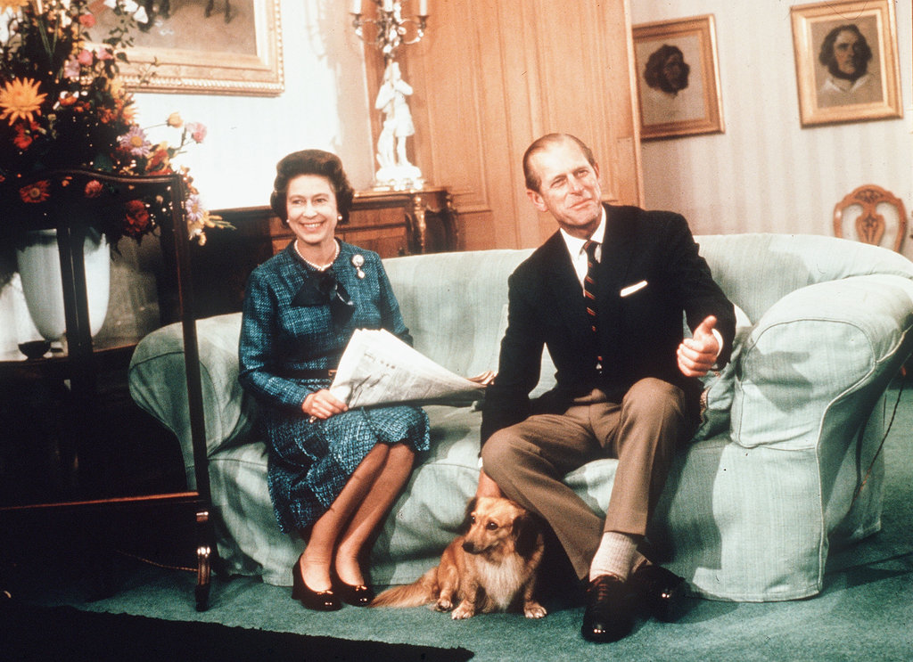 The queen and Prince Philip, the Duke of Edinburgh, relaxed at Balmoral Castle with one of her Dorgis in 1975.