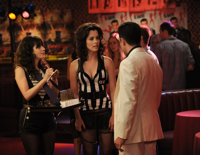Jess takes advice from a cocktail waitress (Parker Posey) on season two of New Girl.