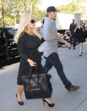 Jessica Simpson held onto Eric Johnson's arm in NYC.