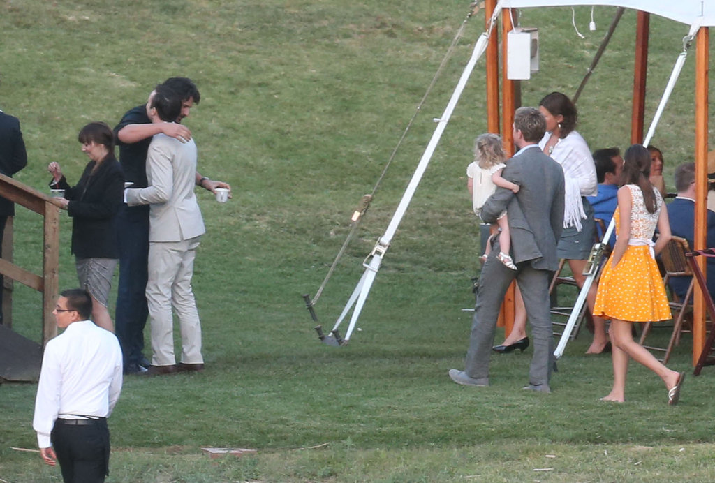 Neil Patrick Harris carried Harper Burtka-Harris across the grass.