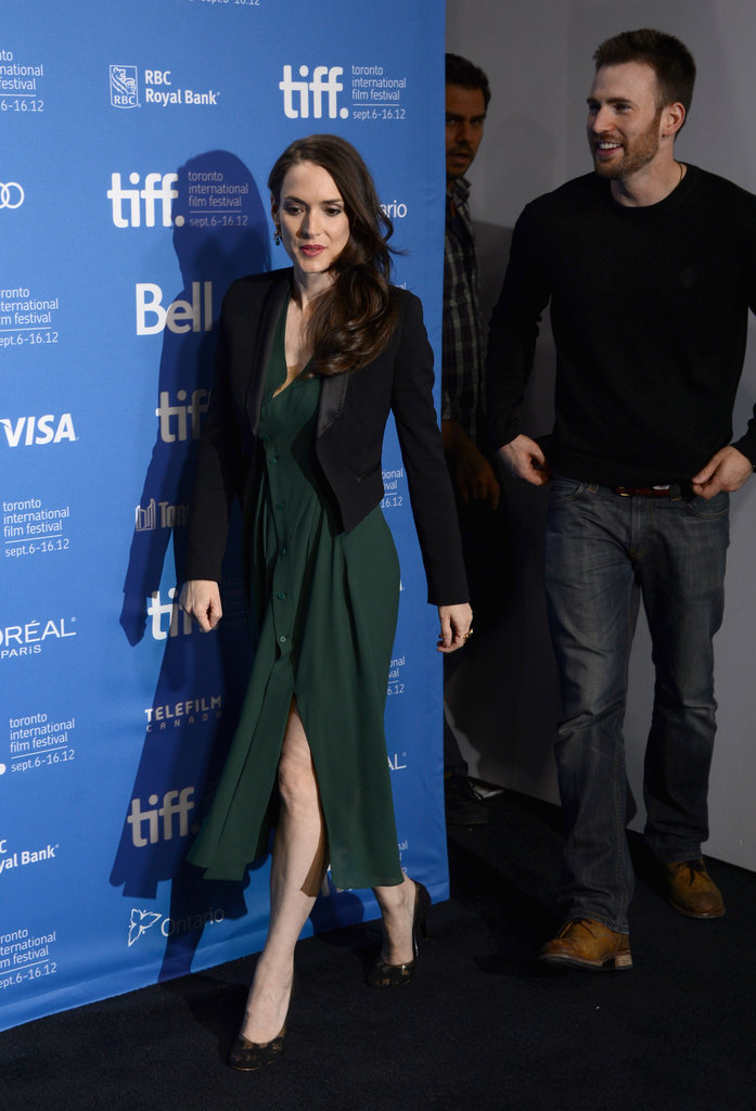 Winona Ryder took the stage at her photocall for The Iceman in a forest green draped dress and slick black blazer.