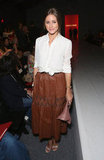 Olivia put a sweet tie-front touch on her luxe brown leather skirt at the Norisol Ferrari show. And to add to the slick texture appeal, she also toted a dusty-pink Valentino clutch.