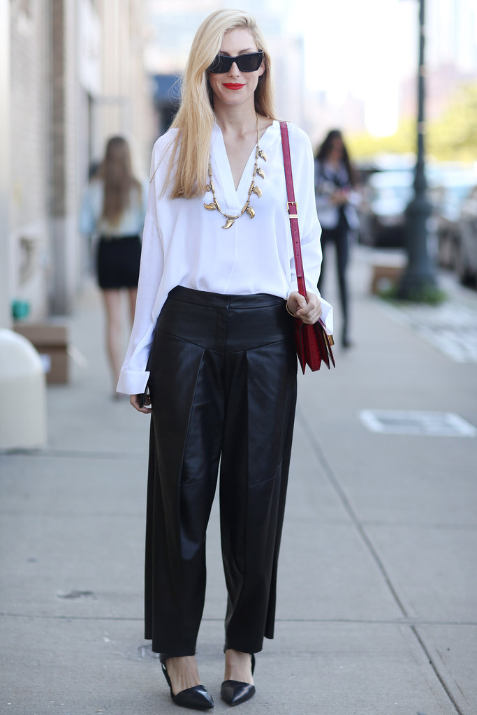 Joanna Hillman's take on white and black is anything but basic with wide leather pants and gold jewels.