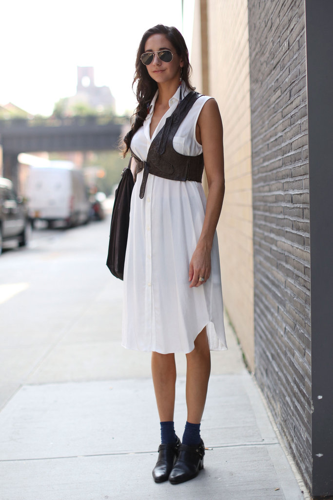 A leather harness-style vest gave ample edge to a white shirtdress.