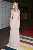 Kirsten Dunst kept it sleek in a soft nude Christian Dior gown at the premiere of On the Road.