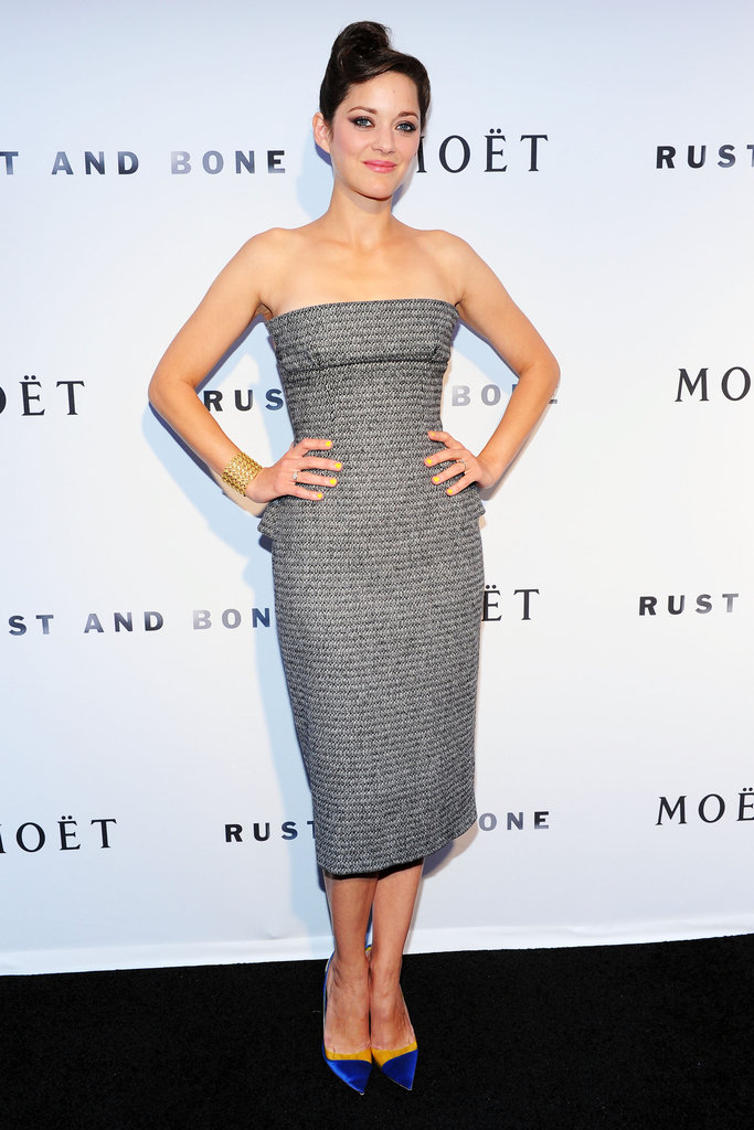 Marion Cotillard struck a subtle peplum note — blink and you'll miss it — in this gray Christian Dior Couture dress at the premiere of her film Rust and Bone.