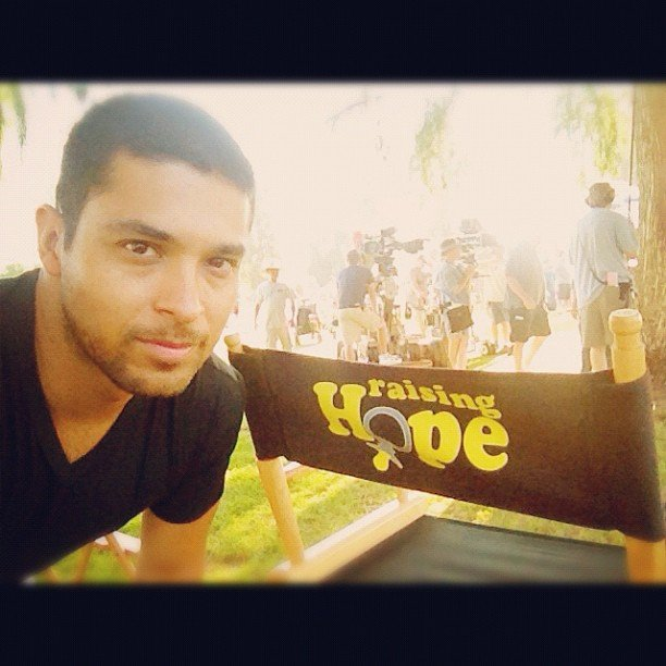 Wilmer Valderrama posed with the director's chair on the set of Raising Hope. Source: Instagram user wilmervalderrama