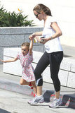 Seraphina Affleck hopped off of the sidewalk while holding hands with Jennifer Garner.