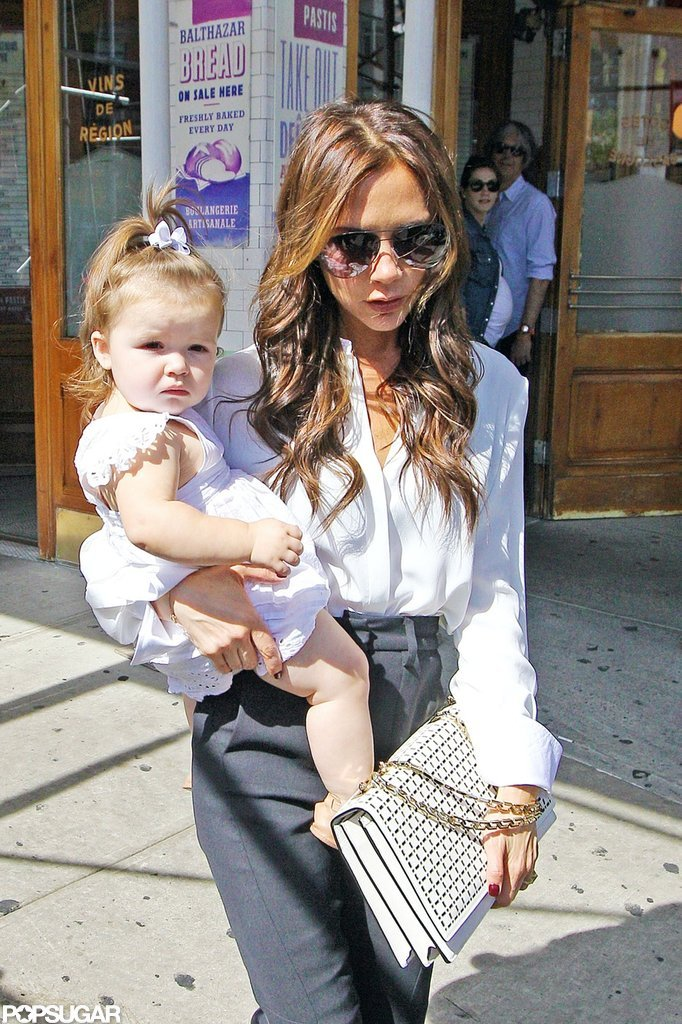 Victoria Beckham carried Harper Beckham out of a restaurant.