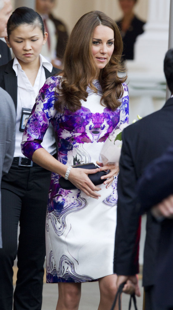 The Duchess teamed her Rorschach dress with a black clutch.