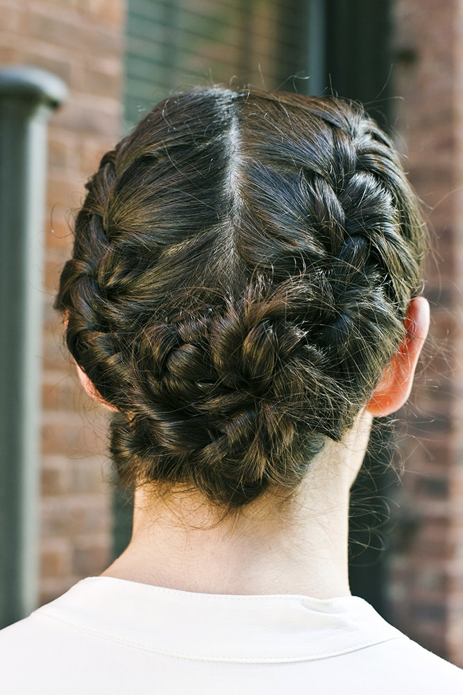 Twist your plaits into a bun to create this gorgeous flower-like shape. Photo by Caroline Voagen Nelson