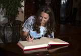 Kate Middleton signed a guest book in Singapore.