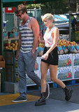 Miley Cyrus held onto Liam Hemsworth's arm entering Whole Foods in LA.