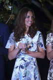 Kate Middleton wore a floral-printed dress to cheers with water.