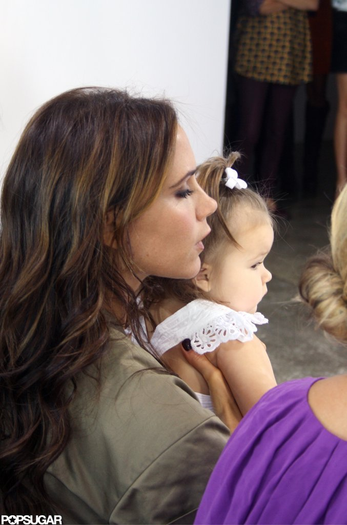 Victoria Beckham held Harper in the front row.
