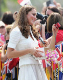 Kate Middleton smiled for pictures with fans in Singapore.