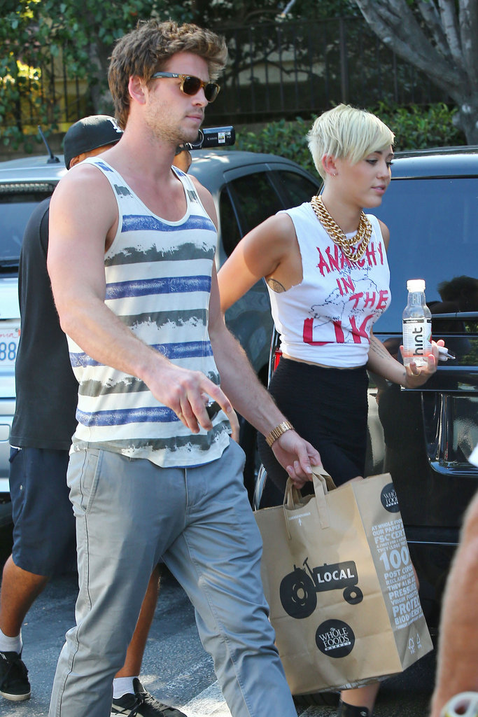 Miley Cyrus and Liam Hemsworth made their way to their car after stopping at the grocery store in LA.
