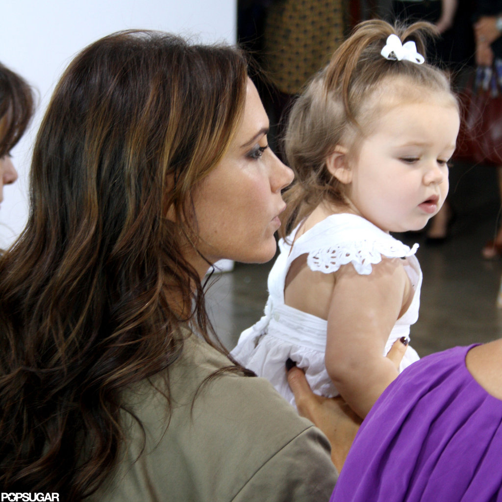Victoria and Harper Beckham watched Victoria's fashion show in NYC.
