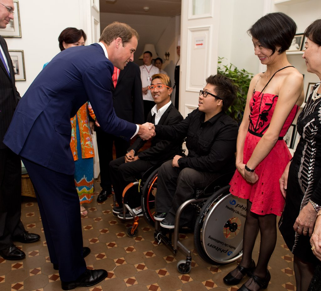 Prince William shook hands at a reception in Singapore.