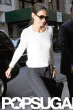 Katie Holmes changed into a white sweater after her NYFW debut.